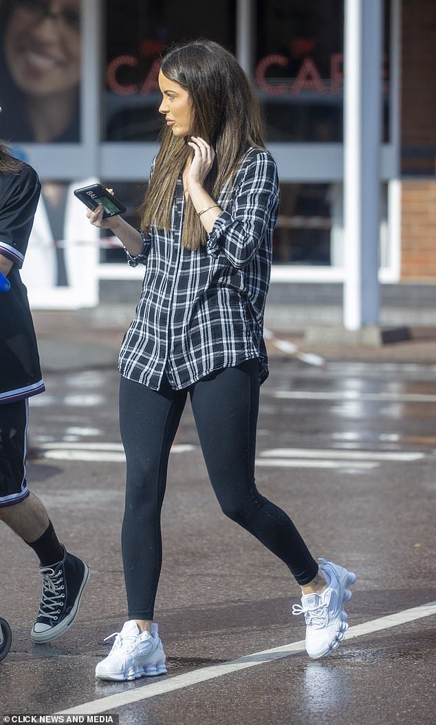 Low key: The Irish beauty teamed the look with black leggings and Balenciaga trainers