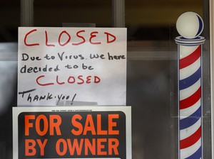 """""""For Sale By Owner"""" and """"Closed Due to Virus"""" signs are displayed in a storefront in Grosse Pointe Woods, Mich. on April 2, 2020. The coronavirus has triggered a stunning collapse in the U.S. workforce."""